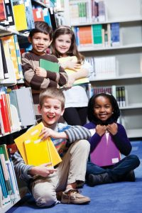 Kids in library setting with books