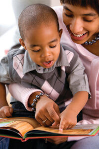 parent and kid reading together
