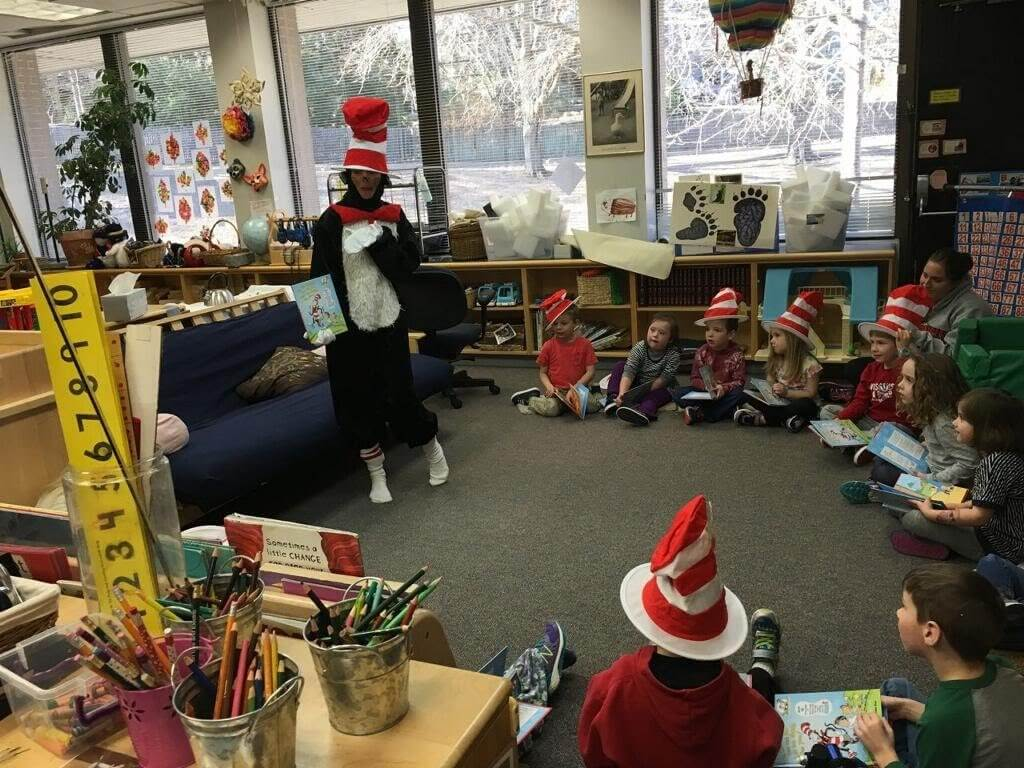 Bob's Discount Furniture public relations director Cathy Poulin reads aloud at an event to a group of preschoolers as Cat in the Hat