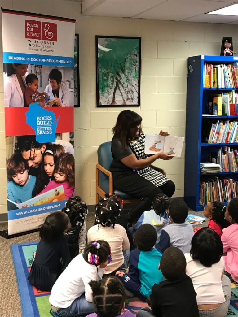 Senator LaTonya Johnson reads aloud to a group of headstart children