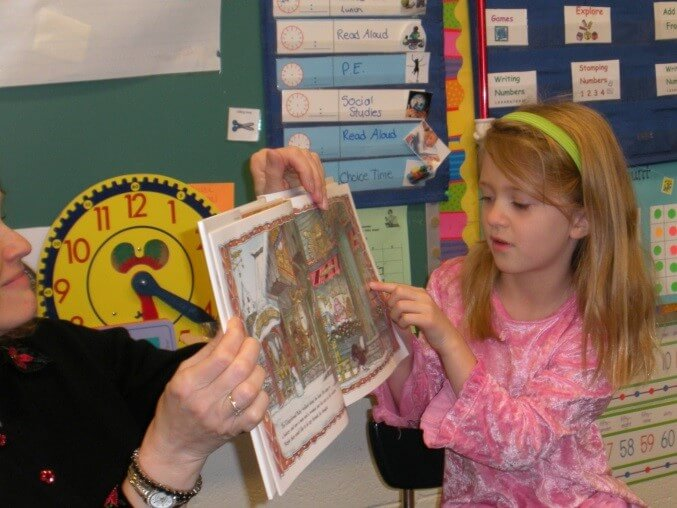 Child sharing book in classroom