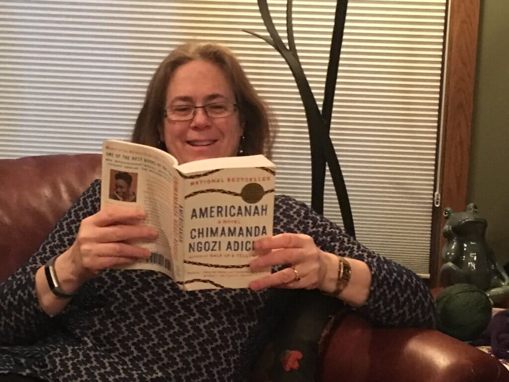 Project Manager Karin Mahony reading a book for her monthly book club