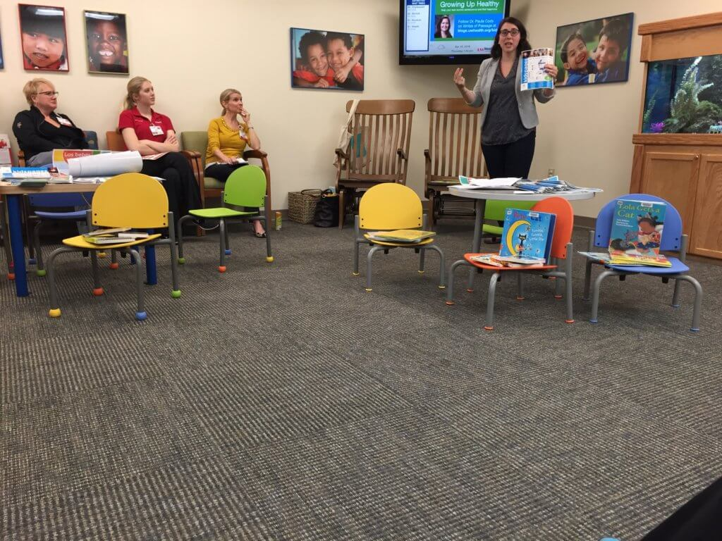Holly Storck-Post speaking to UW Health staff about early literacy over their lunch hour