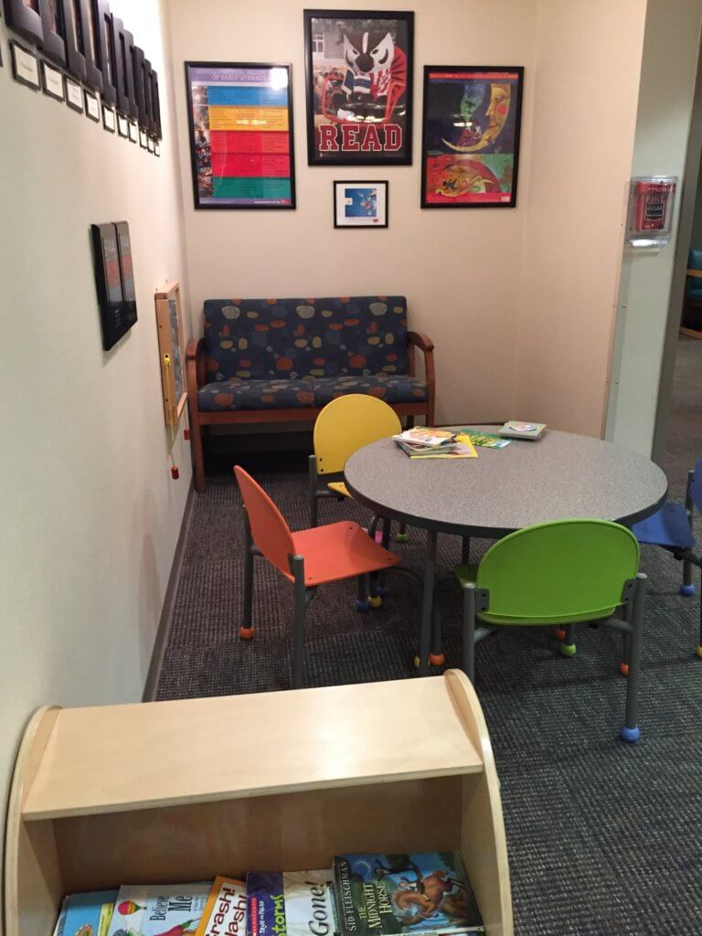 Children's reading area in the waiting room encourages kids to read