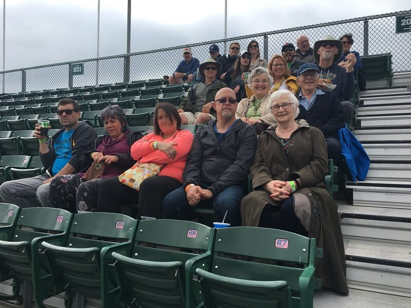 people in bleachers at madison mallards fundraiser