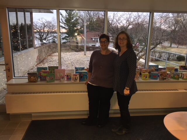 ROR project manager Karin Mahony and Wisconsin Medical Society stand with books that were donated in 2017