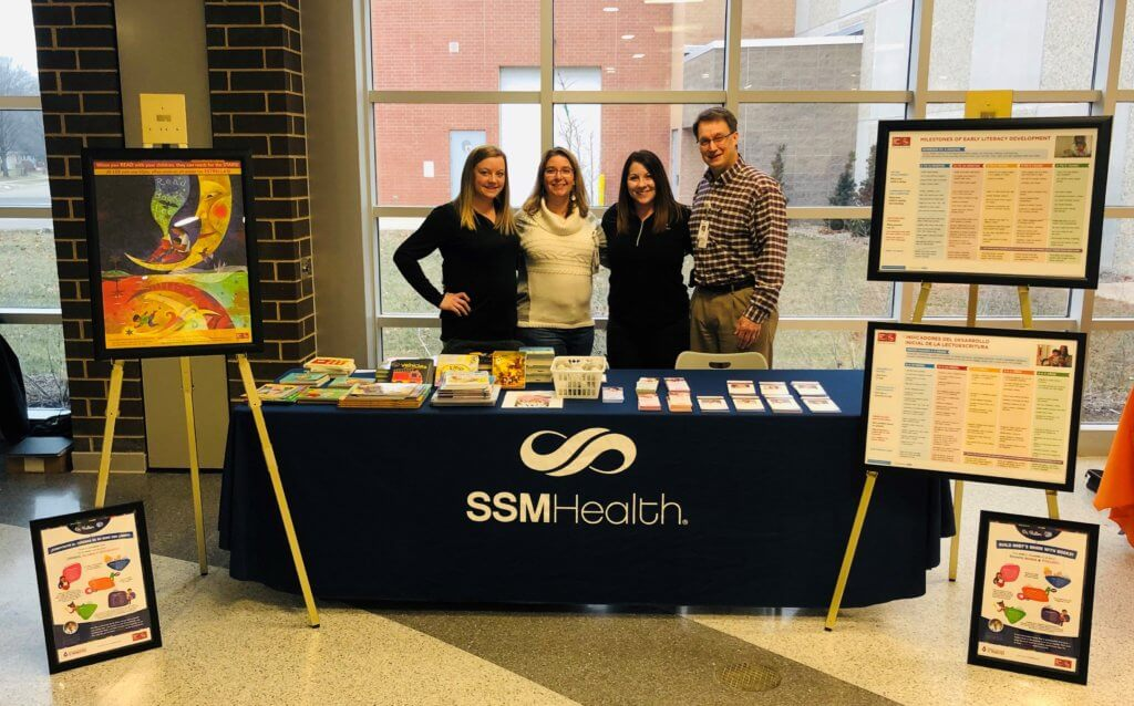 Staff members including Physician Assistant of SSM Health Oregon clinic at Wellness Expo showcasing their Reach Out and Read program